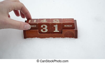 change date new year hand - Hand change date on retro wooden...
