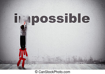 Change impossible to possible - Child erases a word with the...