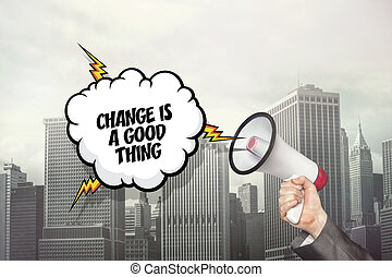 Change is a good thing text on speech bubble and businessman hand holding megaphone