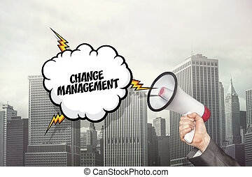 Change management text on speech bubble and businessman hand...
