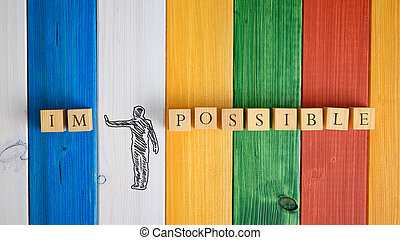 Hand drawn silhouette of a man making a stop gesture to push away letters IM from the word Impossible in a conceptual image. Over colorful wooden background.