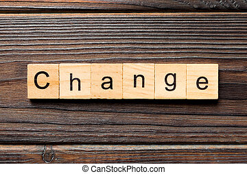 CHANGE word written on wood block. CHANGE text on wooden table for your desing, concept