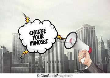 Change your mindset text on speech bubble and businessman hand holding megaphone