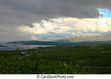 Changeable weather and a rainbow in Abisko valley.