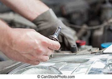 Changing a bulb in a car, horizontal