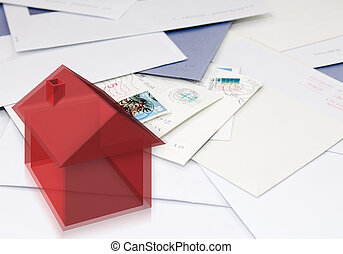 A computer generated, semi-transparant styled image of a house on a stack of mail, indicating change of address, moving, relocating