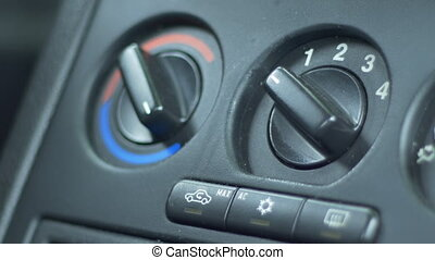 Changing Car Ventilator Speed - Driver is adjusting the fan...