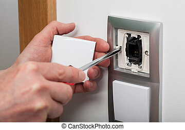 Changing electric socket - Horizontal view of changing the ...