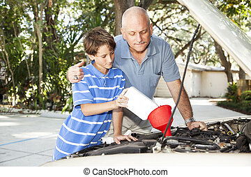 Changing Motor Oil - Father and son changing the motor oil ...