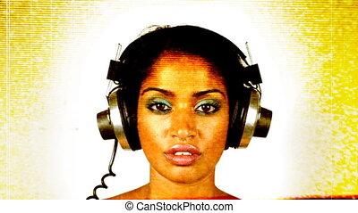 changing retro headphones on a woman's head. very disco