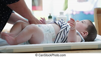 Changing The Babies Nappy - Mother changing the babies nappy...