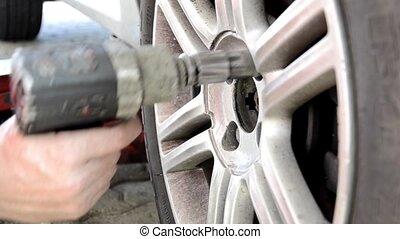 changing tires - automobile repair shop