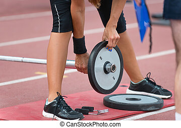 Changing weights on olympic bar by female