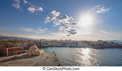 Chania with the amazing lighthouse, mosque, venetian shipyards, at sunset, Crete, Greece.
