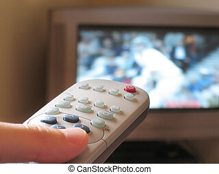 Channel Surfing - Close-up of TV remote control with sport...