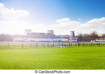 Chantilly racecourse with stands at sunny day
