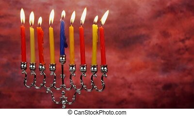 Chanukah candles all in a row. Bright, shiny multicolor candles for the Jewish holiday.