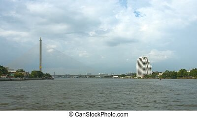Chao Phraya River, Phra Rama 8 Bridge. Thailand, Bangkok. UltraHD 4k video