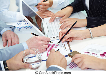 Chaotic briefing - Chaotic place of work with hands of...
