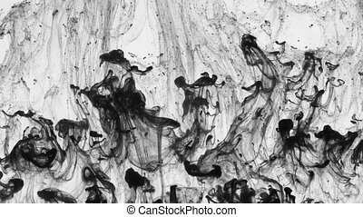 Chaotic movement of drops of black paint in water. Abstract...