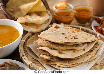 Chapati and roti canai - Chapati or Flat bread, roti canai,...