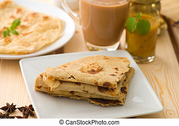 Chapati stacked, Indian flat bread in plate usually served with curry. Popular foods in Malaysia