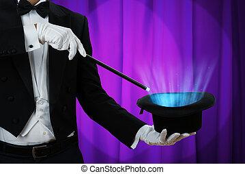 chapeau, sur, tenue, éclairé, magicien, baguette