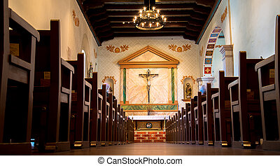landscape of pews and alter and chandelier, at San Luis Obispo mission