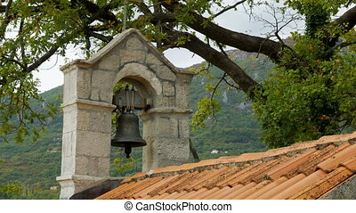 chapel at the cemetery with a bell tower and a large,...