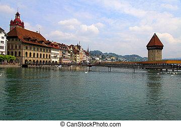 Chapel Bridge and Waterfront of Reuss river, Lucerne, Switzerland. Chapel Bridge is the oldest wooden bridge in Europe, originally built in 14th century.