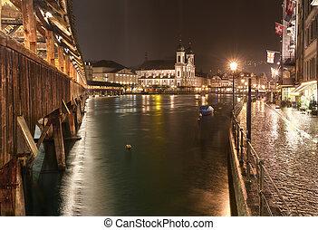 Chapel Bridge (Kappelbr?cke) with Jesuit Chruch at night,...