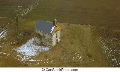 Chapel from the air - Chapel ruines on a field, aerial shot