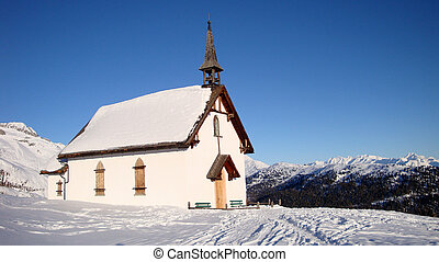 chapel in snow in the austrian alps