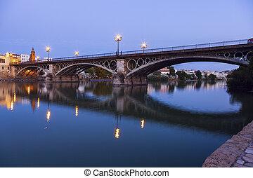 Chapel of Carmen and Isabel II Bridge in Seville. Seville,...