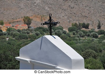 Chapel roof, Symi island - The cross on the roof of a small...