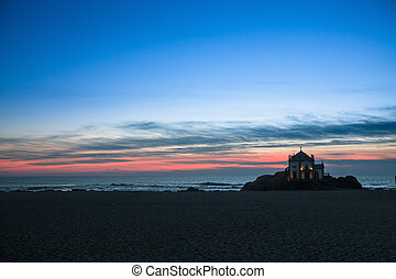 Chapel Senhor da Pedra at night, Miramar Beach, Porto, Portugal.