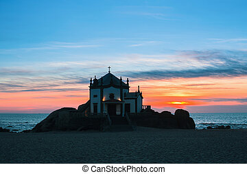 Chapel Senhor da Pedra at night time, Miramar Beach, Portugal.