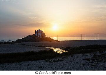 Chapel Senhor da Pedra on Miramar Beach at dusk, Vila Nova de Gaia - Portugal.