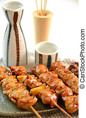 Char-broiled chicken called yakitori. This is a traditional...