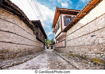 Characteristic street with cobblestones and houses in the historic center of koprivshtitsa (Bulgaria)