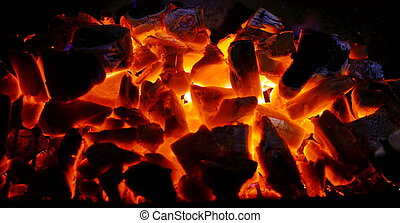 Charcoal burning in a BBQ - Charcoal on fire in a BBQ grill.