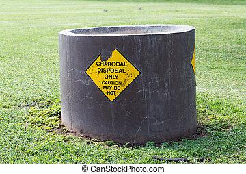 Charcoal disposal at the beach, Hawaii