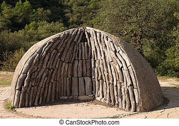 Charcoal kiln - Logs piled up into a traditional charcoal...