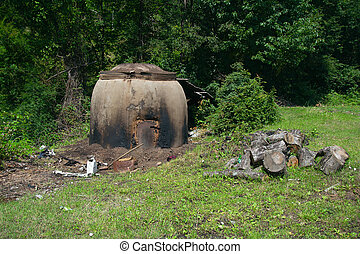 Charcoal kiln on the forest edge near a highway in Serbia