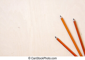 Charcoal Pencils - Charcoal pencils on a wooden desk.