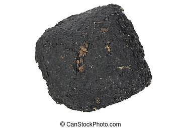 Charcoal - A photo of a piece of charcoal set against a...
