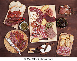 Charcuterie board with cured meat and olives - Charcuterie...