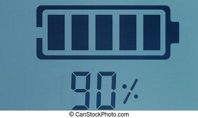 Charger displayin battery at 90 percent closeup