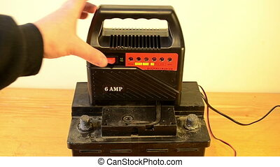 charging car battery hand