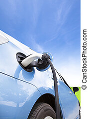Charging of an electric car with cloud background